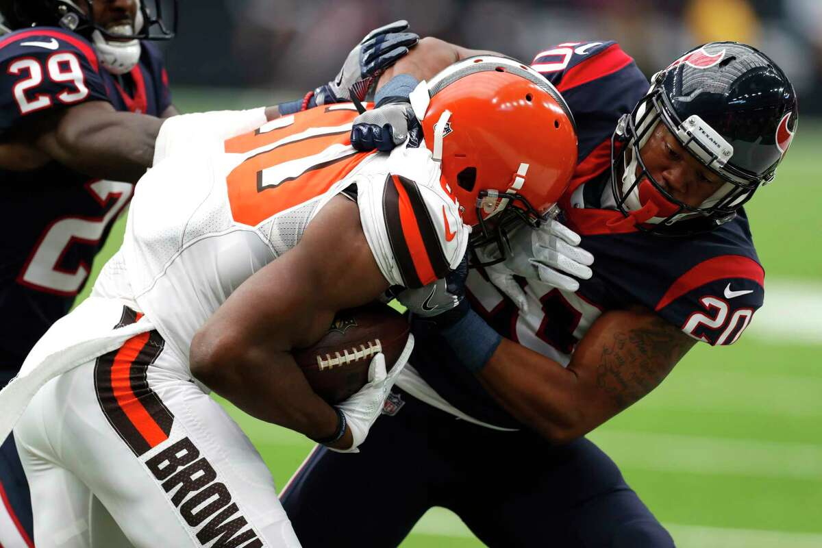 Houston Texans defensive back Marcus Burley (20) tackles Cleveland Browns wide receiver Ricardo Louis (80) during the second quarter of an NFL football game at NRG Stadium on Sunday, Oct. 15, 2017, in Houston.