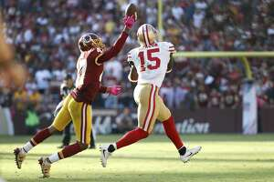 Washington Redskins cornerback Quinton Dunbar (47) reaches to block a pass intended for San Francisco 49ers wide receiver Pierre Garcon (15) during the second half of an NFL football game in Landover, Md., Sunday, Oct. 15, 2017. The Redskins defeated the 49er 26-24. (AP Photo/Alex Brandon)