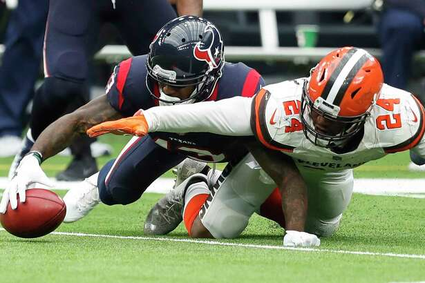 Houston Texans wide receiver Braxton Miller (13) outreaches Cleveland Browns strong safety Ibraheim Campbell (24) to recover an onside kick during the fourth quarter of an NFL football game at NRG Stadium on Sunday, Oct. 15, 2017, in Houston.