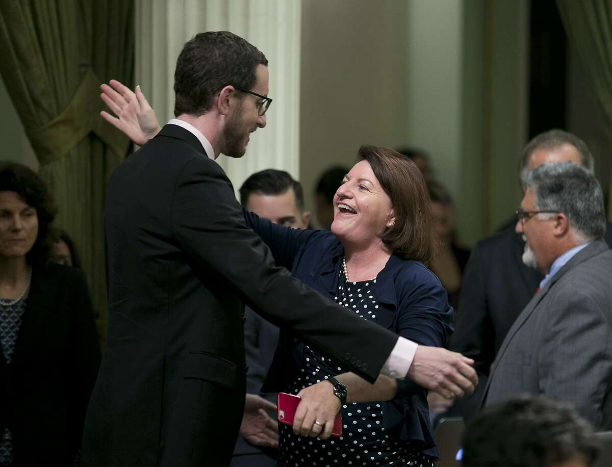 State Sen. Toni Atkins, D-San Diego, receives congratulations from Sen. Scott Wiener, D-San Francisco, after her housing measure was approved by the state Assembly, Thursday, Sept. 14, 2017, in Sacramento, Calif. The California Assembly has approved a multi-bill package to address the state's affordable housing crunch. The bills all need Senate approval on Friday. (AP Photo/Rich Pedroncelli)