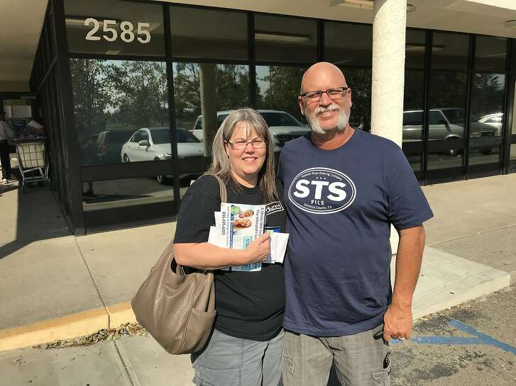 Kathy and Doug Braly collect their mail at their post office branch in Santa Rosa on Saturday.� Braly and two of her brothers all lost their homes in Coffey Park.