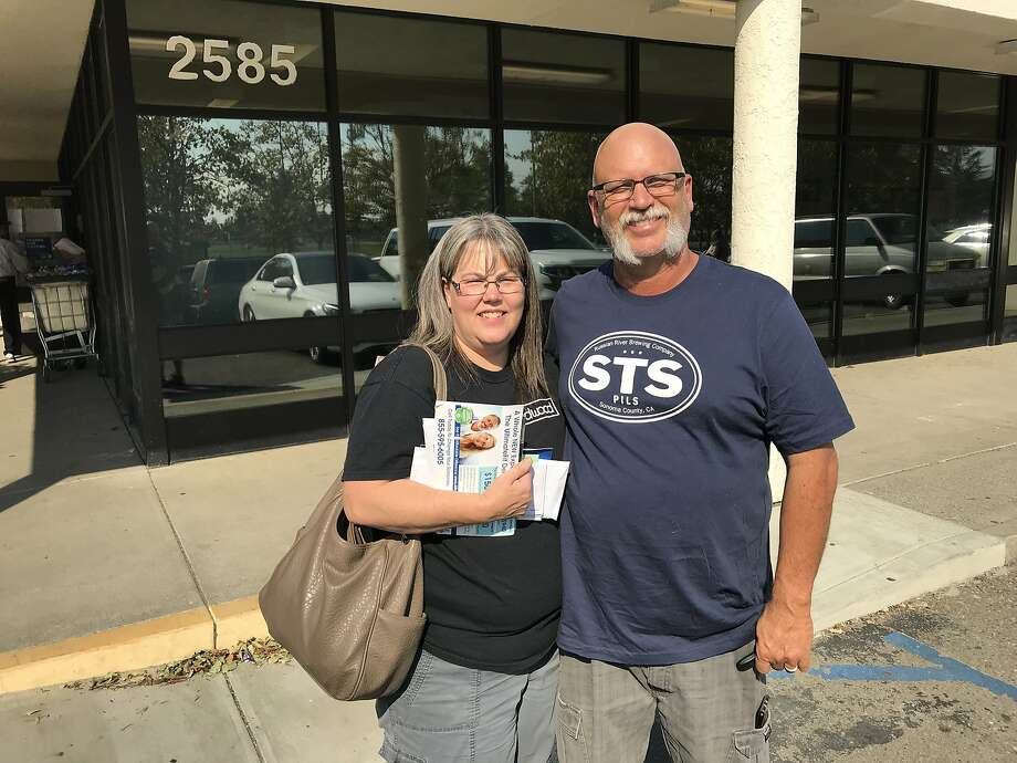 Kathy and Doug Braly collect their mail at their post office branch in Santa Rosa on Saturday.  Braly and two of her brothers all lost their homes in Coffey Park. Photo: Demian Bulwa
