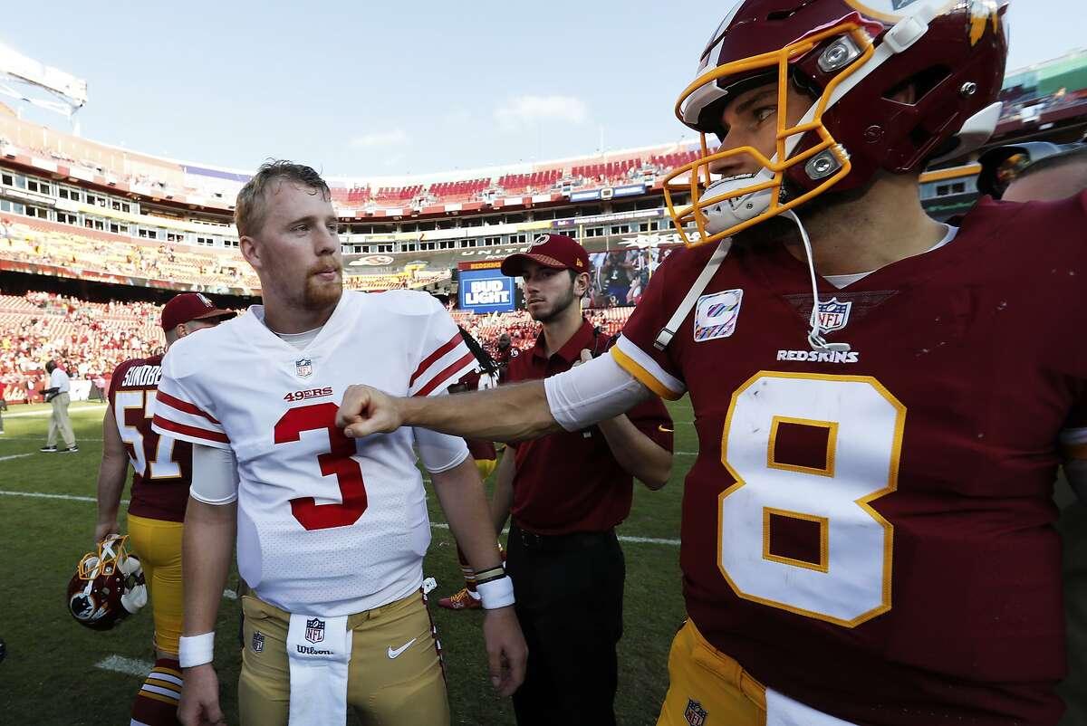 Washington quarterback Kirk Cousins (8) greets San Francisco 49ers quarterback C.J. Beathard (3) after the game.