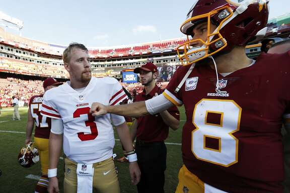 Washington Redskins quarterback Kirk Cousins (8) greets San Francisco 49ers quarterback C.J. Beathard (3) after an NFL football game in Landover, Md., Sunday, Oct. 15, 2017. The Redskins defeated the 49er 26-24. (AP Photo/Alex Brandon)