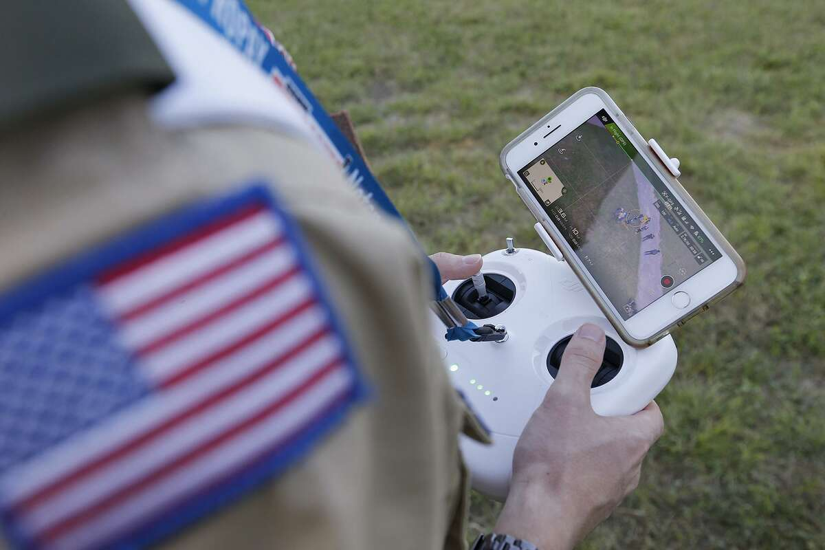 Eagle Scout Michael Chunat, 17, flies a drone during the lock-in, held at Colonial Hills United Methodist Church.