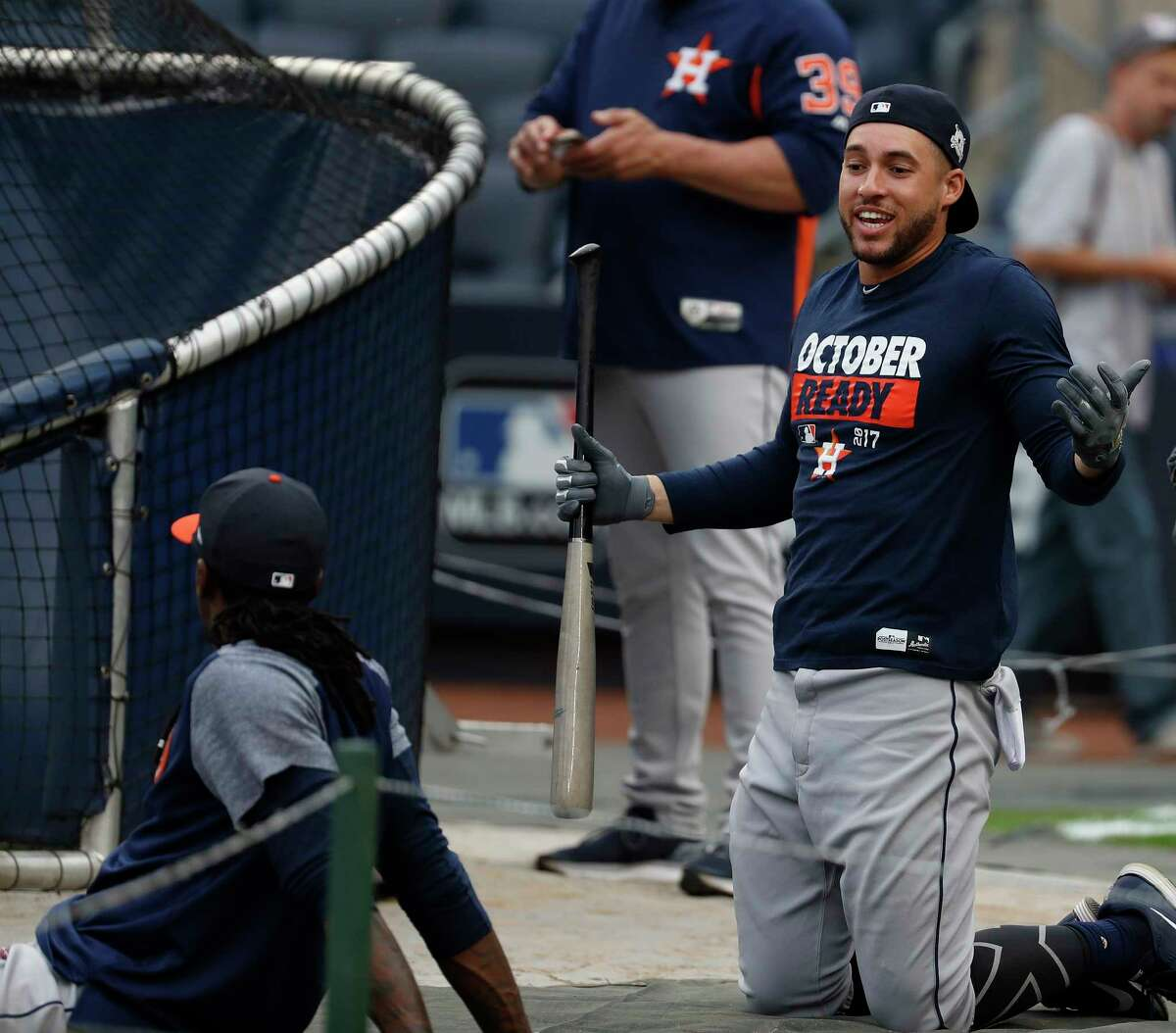 Houston Astros center fielder George Springer talks with Cameron Maybin during the Astros workout at Yankee Stadium, Sunday Oct. 15, 2017, in Houston.