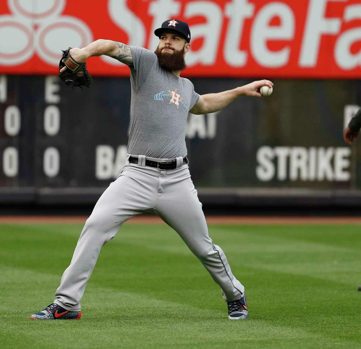 Houston Astros pitcher Dallas Keuchel throws during the Astros workout at Yankee Stadium, Sunday Oct. 15, 2017, in Houston.