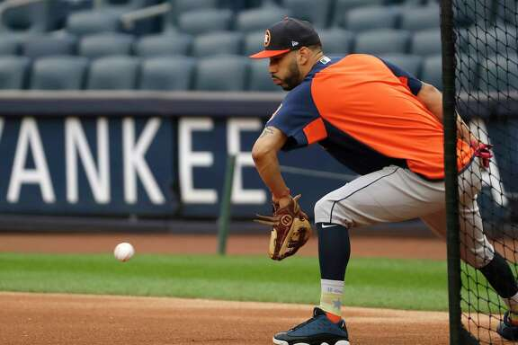 Houston Astros Marwin Gonzalez fields a ball duirng a drill as the Astros worked out at Yankee Stadium, Sunday Oct. 15, 2017, in Houston.