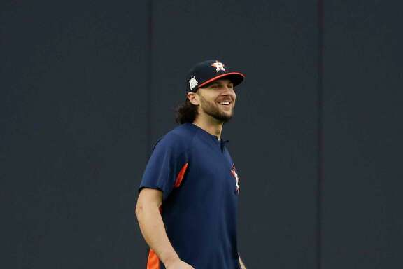 Houston Astros Jake Marisnick shags balls in the outfield during the Astros workout at Yankee Stadium, Sunday Oct. 15, 2017, in Houston.