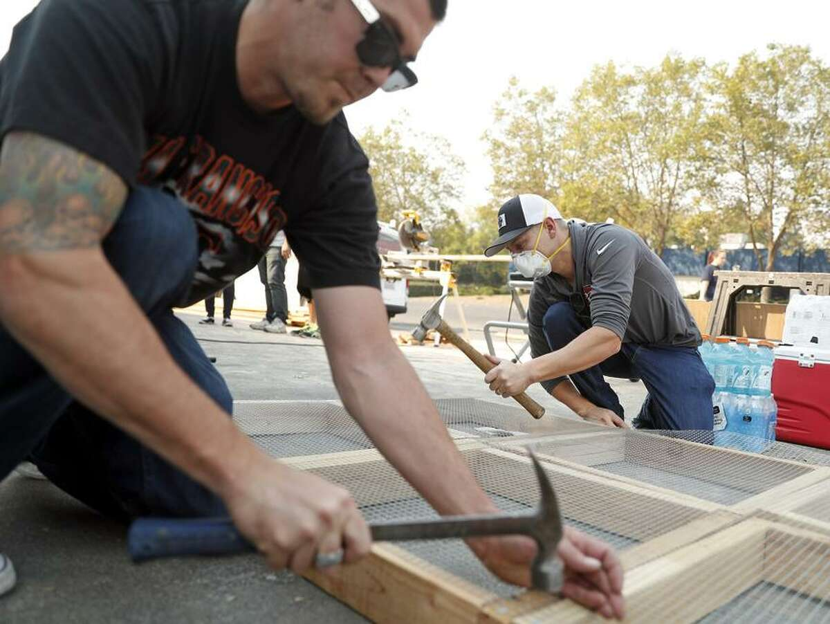 Pacific Coast Custom Interiors' co-owner Evan Nelson (left) and Travis Sawyer make free ash sifters in Santa Rosa.