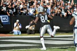 OAKLAND, CA - OCTOBER 15:  Cordarrelle Patterson #84 of the Oakland Raiders scores on a 47-yard touchdown against the Los Angeles Chargers during their NFL game at Oakland-Alameda County Coliseum on October 15, 2017 in Oakland, California.  (Photo by Don Feria/Getty Images)