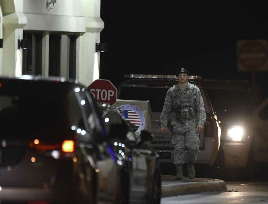A sentry mans the front gate at JBSA Randolph during a lockdown after a car through a fence there on Saturday. Photo: Billy Calzada /San Antonio Express-News / San Antonio Express-News