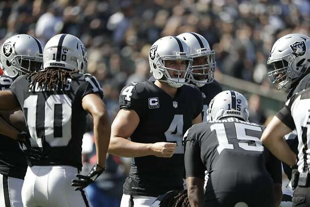 Oakland Raiders quarterback Derek Carr (4) in the huddle on Sunday, Oct. 15, 2017 in Oakland, CA.