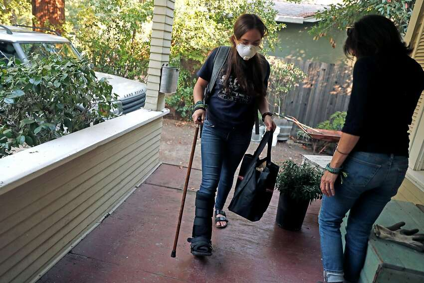 After the evacuation order was lifted, Sofia Osborne, 15 and her mother, Kim Wedlake, return to their home on Cedar Street in Calistoga, Calif., on Sunday, October 15, 2017.