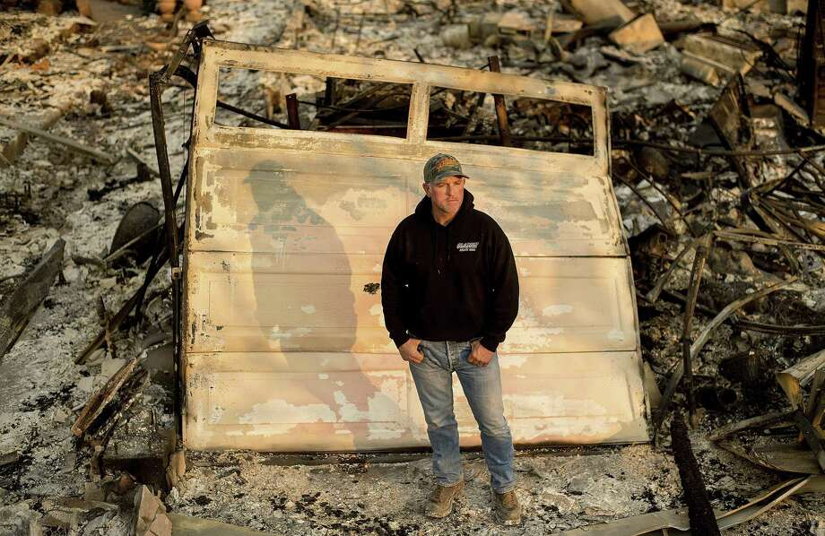 Santa Rosa firefighter Tony Niel stands Thursday in front of what was once his Mark West Estates home, which burned during the Tubbs fire. Niel is among an estimated 40 California active-duty firefighters who have lost their homes in the Wine Country fires . Photo: Noah Berger / Special To The Chronicle / online_yes
