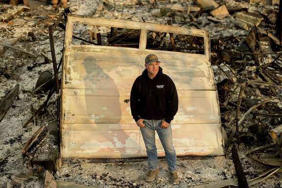 Santa Rosa firefighter Tony Niel stands Thursday in front of what was once his Mark West Estates home, which burned during the Tubbs fire. Niel is among an estimated 40 California active-duty firefighters who have lost their homes in the Wine Country fires .