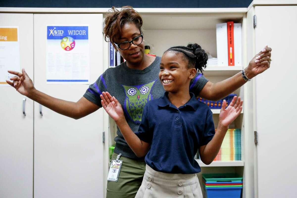 Outley Elementary third grade teacher Myra Yorke dances with Breanna Calvin, 8, whose home was damaged during Hurricane Harvey.