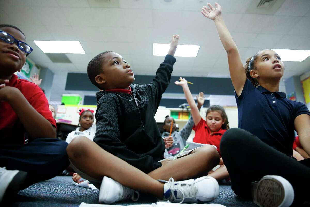 Nine-year-old Antwon Patrick, center, is one of 20 students at Outley Elementary who started attending the school after being displaced by Hurricane Harvey.