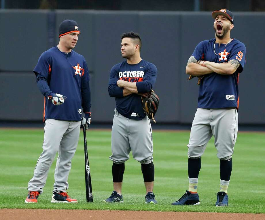 Astros third baseman Alex Bregman, left, appears to have the attention of teammate Jose Altuve, center, but Marwin Gonzalez, right, has his mind on other things during the Sunday workout. Photo: Karen Warren, Houston Chronicle / @ 2017 Houston Chronicle