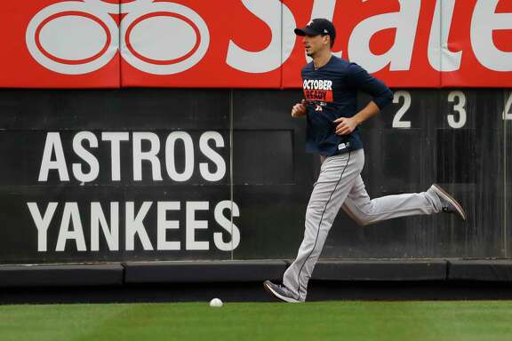 Astros pitcher Charlie Morton runs on the Yankee Stadium warning track Sunday. Morton, who grew up a Yankees fan, is calling his Game 3 start Monday the biggest game of his career.