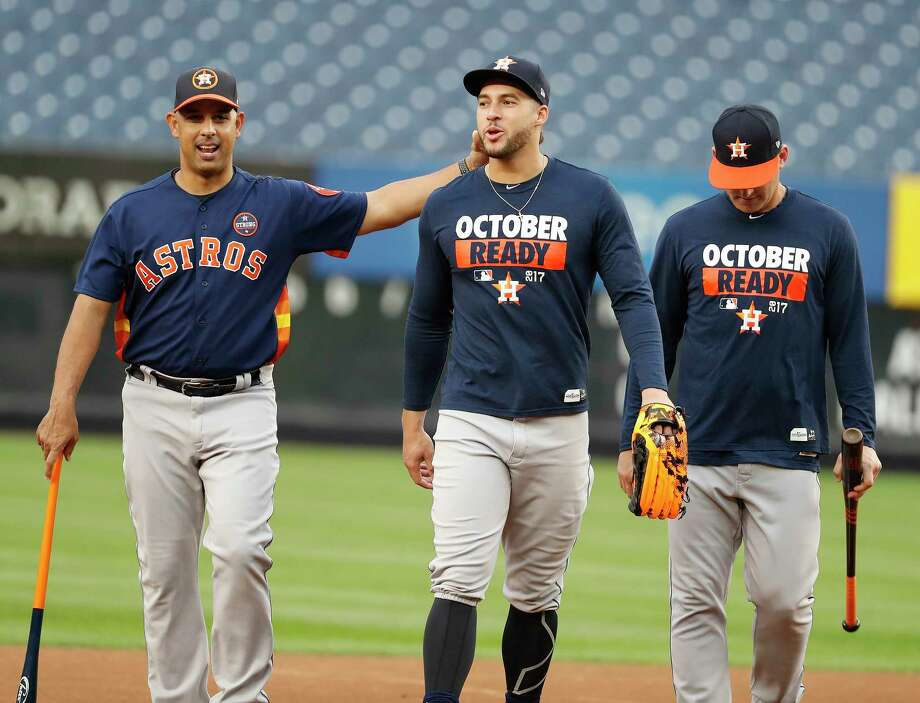 Astros bench coach Alex Cora, left, with outfielder George Springer during Sunday's workout at Yankee Stadium, is expected to interview for at least three managerial openings. Photo: Karen Warren, Houston Chronicle / @ 2017 Houston Chronicle