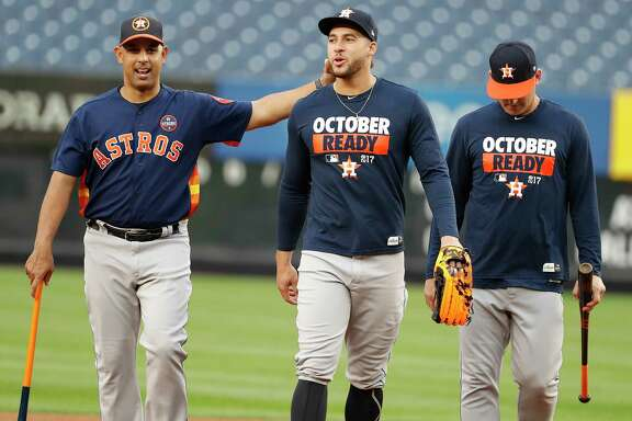 Astros bench coach Alex Cora, left, with outfielder George Springer during Sunday's workout at Yankee Stadium, is expected to interview for at least three managerial openings.