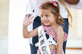 Alexis Lynn Masters waves as she is crowned Catfish Festival Queen on Sunday in downtown Conroe.
