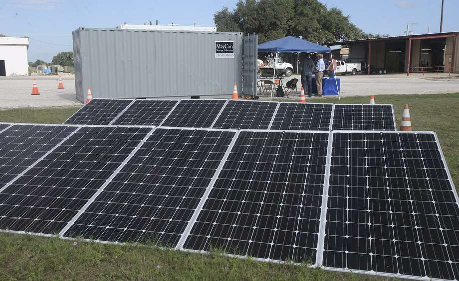 A dozen solar panels sit on the grounds of Bandera Electric Cooperative. The panels were being used to test control and safety systems within a test bed for a solar-diesel hybrid system that will be sent to a small town in Liberia. Photo: John Davenport /San Antonio Express-News / ©John Davenport/San Antonio Express-News
