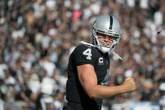 Oakland Raiders quarterback Derek Carr (4) celebrates a 2nd half TD on Sunday, Oct. 15, 2017 in Oakland, CA.