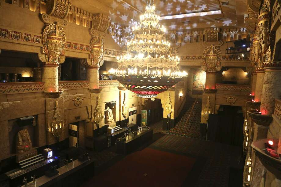 One of the most distinctive touches in the Aztec Theatre's lobby is the chandelier, which is two stories tall and 12 feet wide. Photo: John Davenport /San Antonio Express-News / ©John Davenport/San Antonio Express-News
