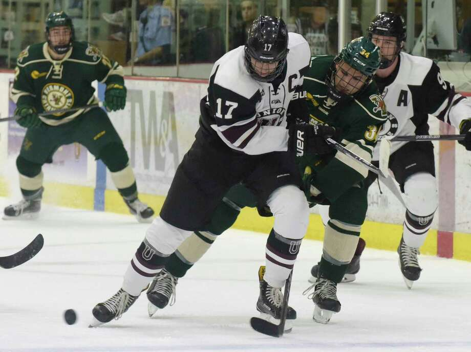 Cole Maier, left, of Union, and Jake Massie of Vermont battle for the puck during their game at Union College on Sunday, Oct. 15, 2017, in Schenectady, N.Y.  (Paul Buckowski / Times Union) Photo: PAUL BUCKOWSKI / 20041843A