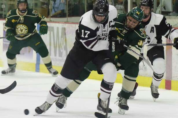 Cole Maier, left, of Union, and Jake Massie of Vermont battle for the puck during their game at Union College on Sunday, Oct. 15, 2017, in Schenectady, N.Y.  (Paul Buckowski / Times Union)