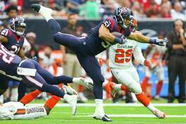 Houston Texans inside linebacker Dylan Cole (51) returns an interception during the first half of an NFL football game at NRG Stadium on Sunday, Oct. 15, 2017, in Houston. ( Mark Mulligan / Houston Chronicle )