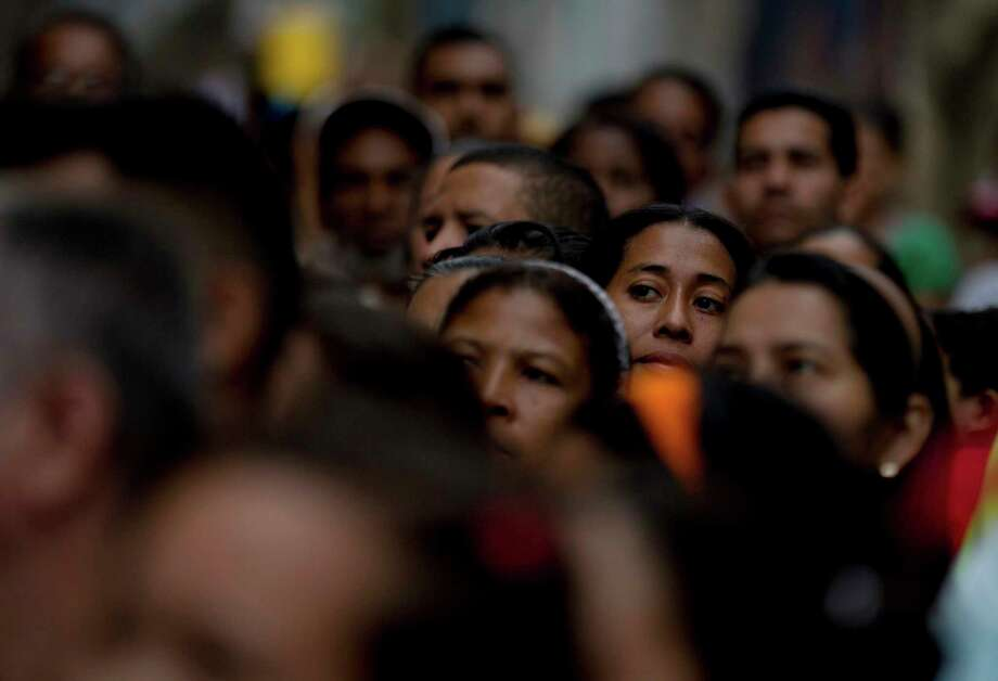 Voters wait in line to cast their ballots for regional elections outside a polling station in Caracas, Venezuela, Sunday, Oct. 15, 2017. Elections could tilt a majority of the states' 23 governorships back into opposition control for the first time in nearly two decades of socialist party rule, though the government says the newly elected governors will be subordinate to a pro-government assembly.(AP Photo/Fernando Llano) Photo: Fernando Llano, STF / Copyright 2017 The Associated Press. All rights reserved.