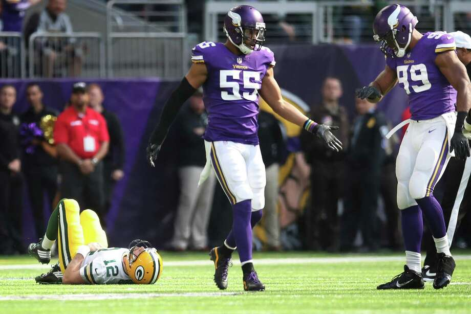 Green Bay quarterback Aaron Rodgers lies on the turf after breaking his collarbone on a tackle by Minnesota linebacker Anthony Barr (55) in the first quarter Sunday in Minneapolis. Photo: Jerry Holt, MBR / Minneapolis Star Tribune