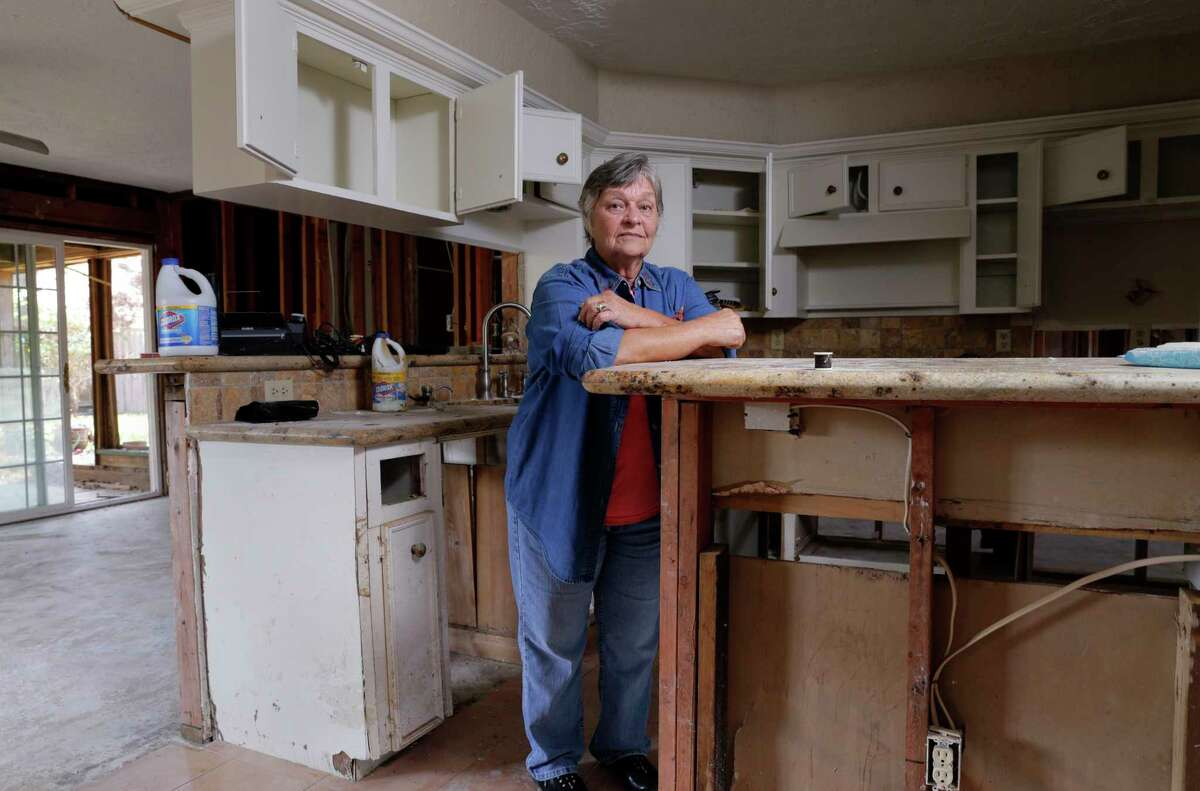 Mary Bessinger in the kitchen of her stripped down house, flood damaged from hurricane Harvey, as renovation continues at her home in Houston, TX, Oct. 11, 2017. (Michael Wyke / For the Chronicle)