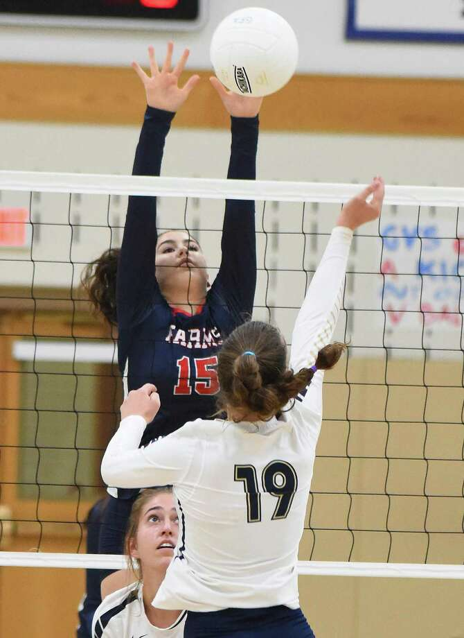 Greens Farms Academy volleyball player Kris Modzelewski, a resident of Westport, blocks a ball during Saturday's Homecoming against King at Coyle Gym in Westport. Photo: Contributed Photo/Hearst Media Connecticut