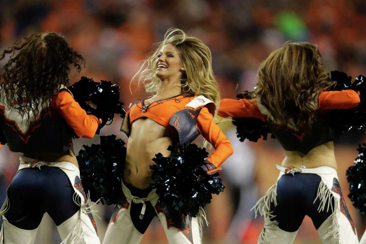 Denver Broncos cheerleaders perform during the second half of an NFL football game against the New York Giants Sunday, Oct. 15, 2017, in Denver. (AP Photo/Joe Mahoney)