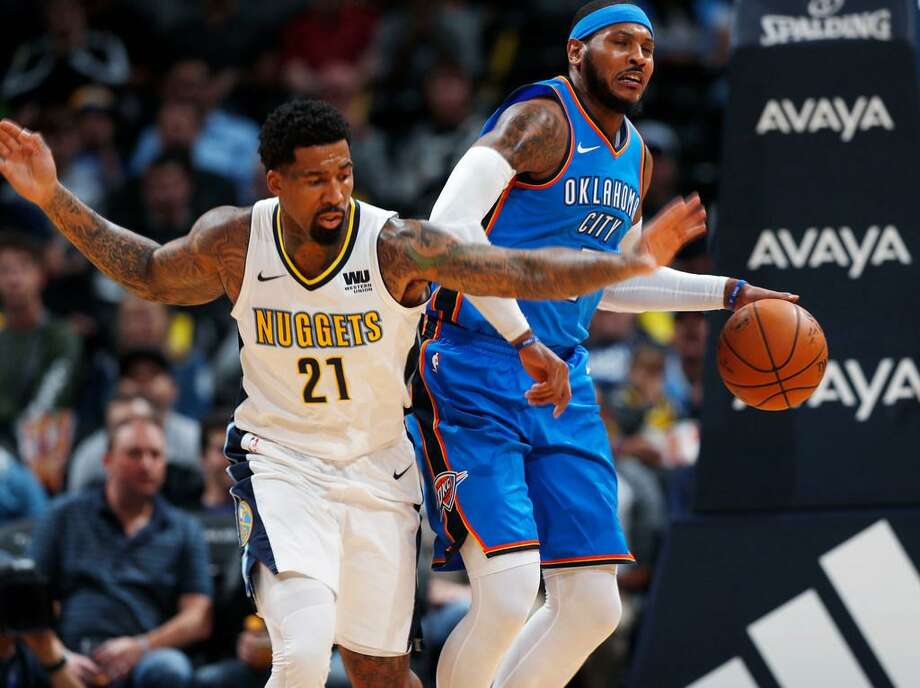 Denver Nuggets forward Wilson Chandler, left, tries to steal the ball from Oklahoma City Thunder forward Carmelo Anthony in the first half of an NBA preseason basketball game Tuesday, Oct. 10, 2017, in Denver. Photo: David Zalubowski /AP Photo