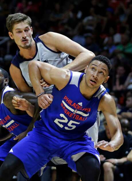Philadelphia 76ers forward Ben Simmons (25) and Utah Jazz center Tibor Pleiss, rear, battle under the boards for a rebound during the second half of an NBA summer league basketball game Thursday, July 7, 2016, in Salt Lake City. Photo: Rick Bowmer /AP Photo