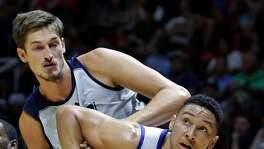 Philadelphia 76ers forward Ben Simmons (25) and Utah Jazz center Tibor Pleiss, rear, battle under the boards for a rebound during the second half of an NBA summer league basketball game Thursday, July 7, 2016, in Salt Lake City.
