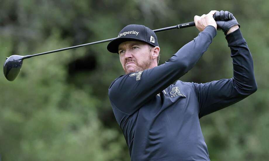 Jimmy Walker grimmaces as he hits his drive into a stiff wind on the 9th teebox during the third round of the Valero Texas Open at TPC San Antonio Oaks Course on April 22, 2017. Photo: Tom Reel, Staff / San Antonio Express-News / 2017 SAN ANTONIO EXPRESS-NEWS