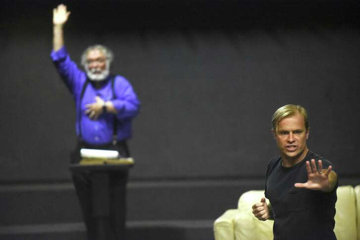 "John Stillwaggon, right, playing the part of God, makes a point during a rehearsal of the Sheldon Vexler Theater production of ""An Act of God."" Michael Howard (left) plays the angel Gabriel."