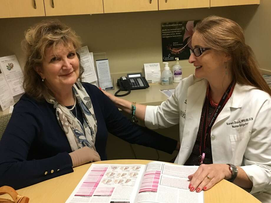 Iris Gerken, left, of Katy received guidance from nurse navigator Karen Davin at the Bobetta Lindig Breast Care Center at Memorial Hermann Memorial City, during her journey to fight breast cancer. Through Davin's encouragement, Gerken has become a CanCare volunteer to help others who have been diagnosed with cancer. Photo: Karen Zurawski