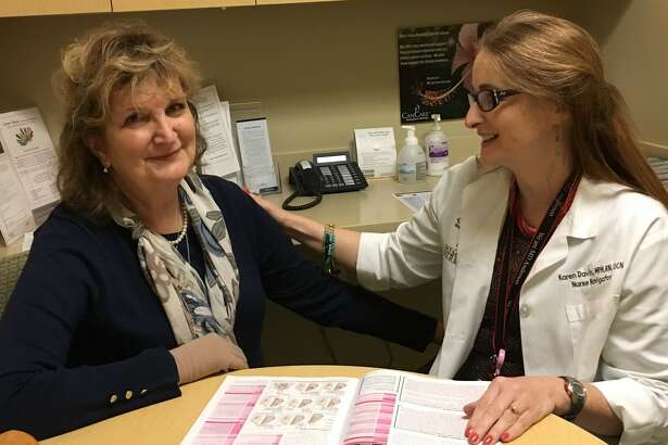 Iris Gerken, left, of Katy received guidance from nurse navigator Karen Davin at the Bobetta Lindig Breast Care Center at Memorial Hermann Memorial City, during her journey to fight breast cancer. Through Davin's encouragement, Gerken has become a CanCare volunteer to help others who have been diagnosed with cancer.