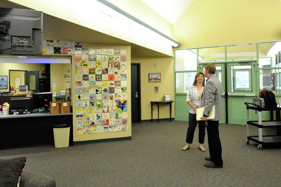 Katy ISD Chief Operating Officer Lee Crews and Fielder Elementary School Principal Mona Cardin discuss renovations needed at the campus on Oct. 11. Voters in Katy ISD approved a $609-million bond proposal that will finance improvements at the school. Photo: Craig Moseley, Staff / ©2017 Houston Chronicle