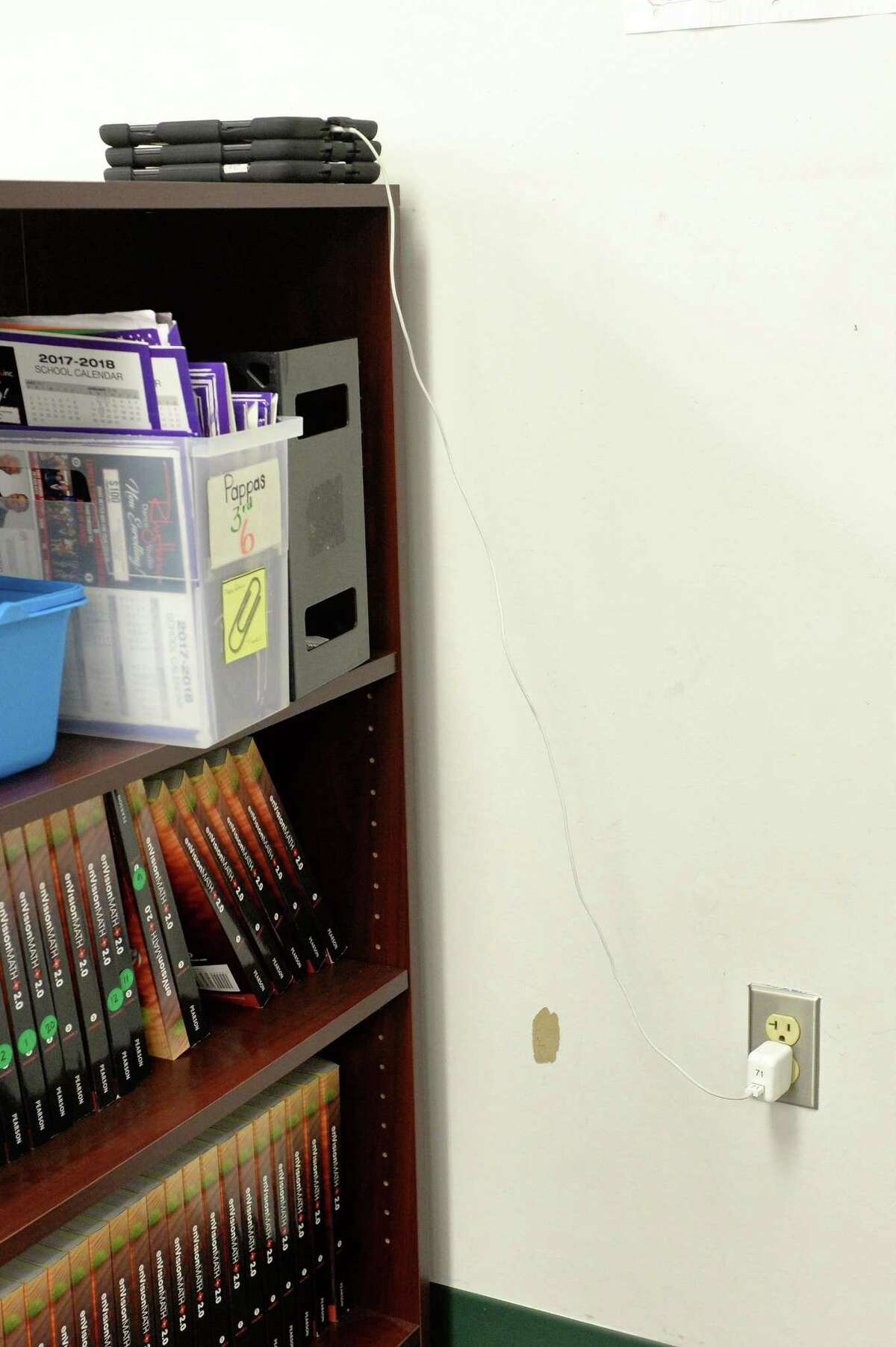 Outdated electrical systems at Fielder Elementary School require that devices be re-charged one at a time.