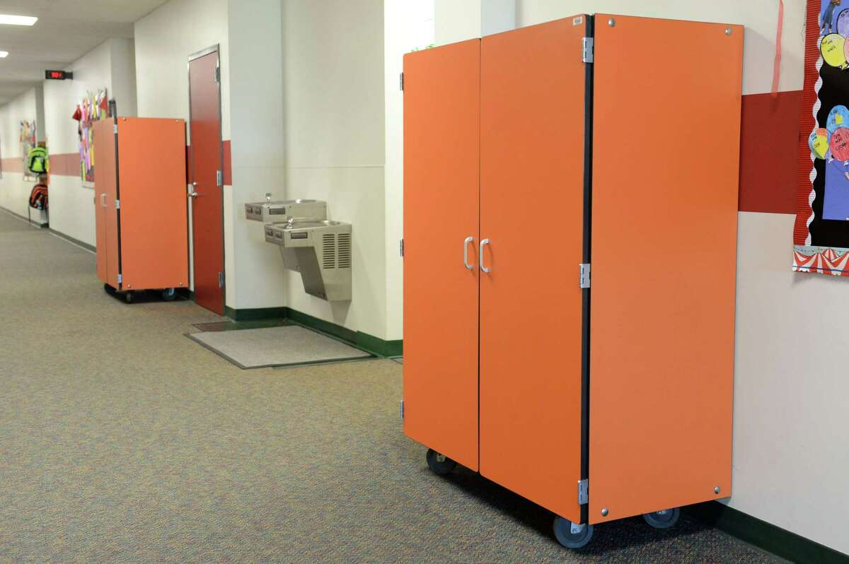 Temporary storage lockers in hallways are necessary due to the current shortage of storage space for instructional materials in classrooms at Katy ISD's Fielder Elementary School in Katy on Oct. 11, 2017.