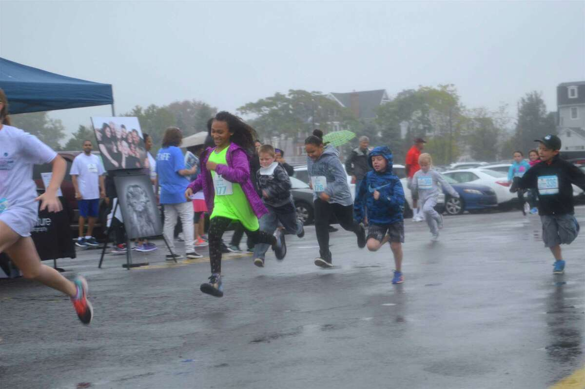 Lots of smiles for the kids' fun run at the 11th annual Walk-Run for Hope fundraiser for CancerCure, held at Jennings Beach on Sunday, Oct. 15, 2017, in Fairfield, Conn.