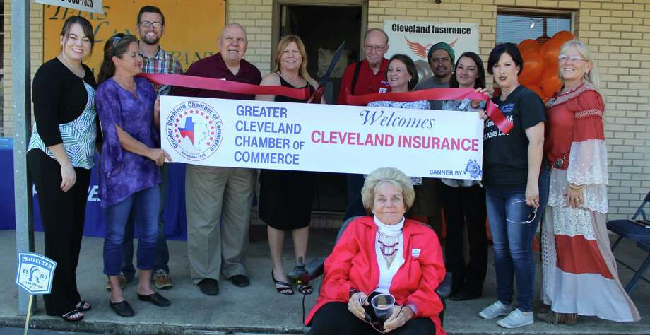 The Greater Cleveland Chamber of Commerce welcomes Cleveland Insurance with a ribbon cutting ceremony on Oct. 11. Insurance Agent Kelly Barton cuts the ribbon to welcome her business. Photo: Jacob McAdams